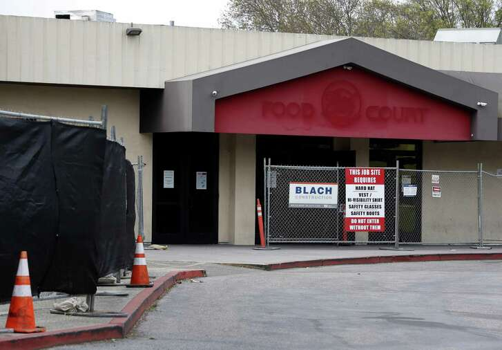 An entrance to the Food Court of the Vallco shopping mall is fenced off in Cupertino, Calif. on Wednesday, Feb. 14, 2018. Few tenants remain at the mall in the western Santa Clara Valley, including an AMC Theater and a couple of restaurants, but it is largely abandoned.