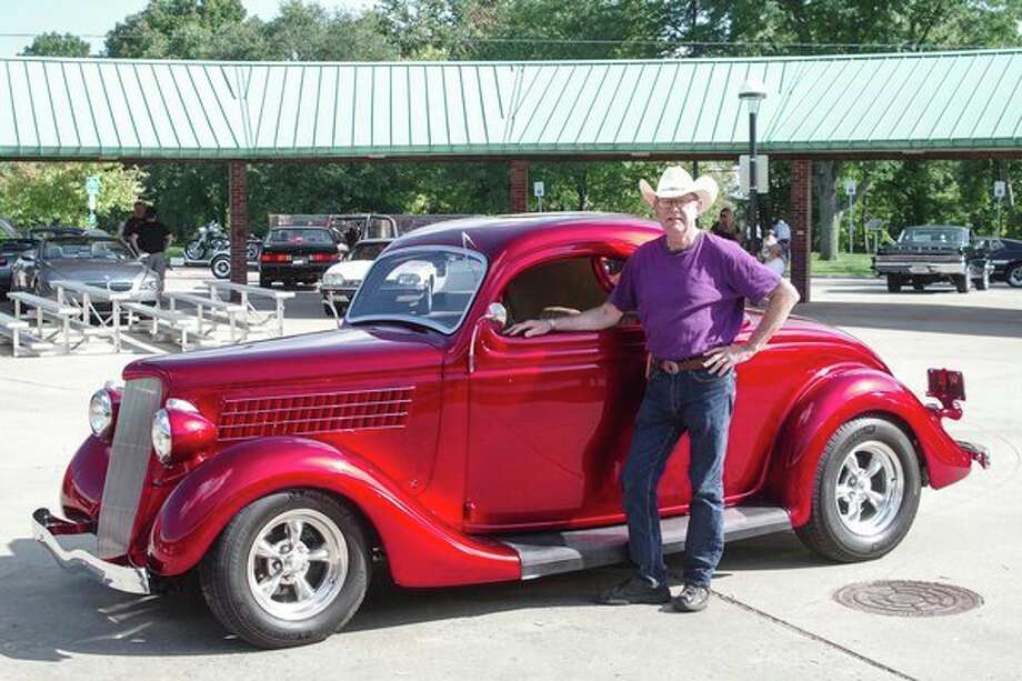 Doug Winslow of Midland stands near his 1935 Ford three-window coupe, which was was named Best of Show as the 29th annual Midland Cruise 'N Car Show ended at the Midland Area Farmers Market. (Photo provided) / ©2018 Stuart Frohm