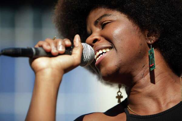 """SassyBlack performs during a free """"Save the Showbox"""" concert outside of City Hall, Wednesday, before a public City Council hearing on the issue, Sept. 19, 2018."""
