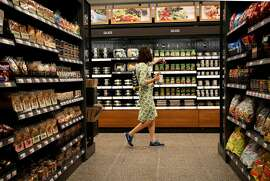 Irena Kubiliene shops at the new Amazon Go store on the 100 block of South Franklin Street on Monday, Sept. 17, 2018 in Chicago, Ill. (Stacey Wescott/Chicago Tribune/TNS)
