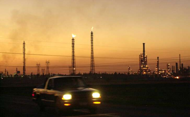 A truck passes by a giant refinery in Salamanca, 170 miles (280 kms) northwest of Mexico City