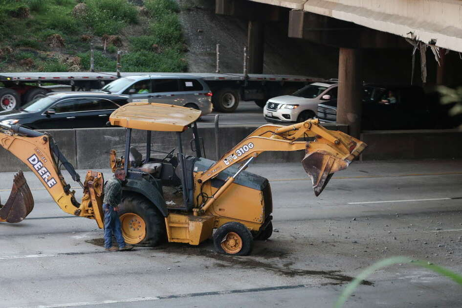 A lost load of construction equipment on Interstate Highway 10 westbound at Waco Street has blocked three main lanes and delayed the morning traffic on Thursday, Sept. 20, 2018, in Houston. It appears that the situation happened when the vehicle carrying the construction equipment struck the Waco Street bridge.