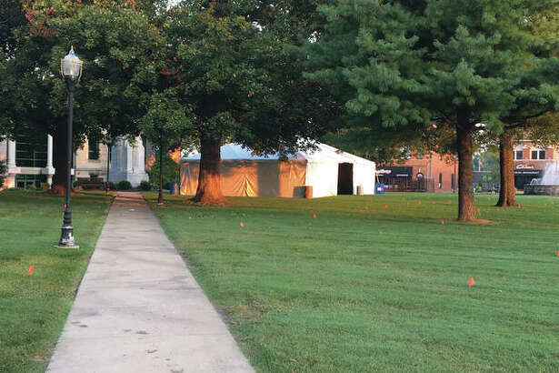 The first of dozens of tents sits erected Thursday morning at Edwardsville City Park in anticipation of the Edwardsville Art Fair.