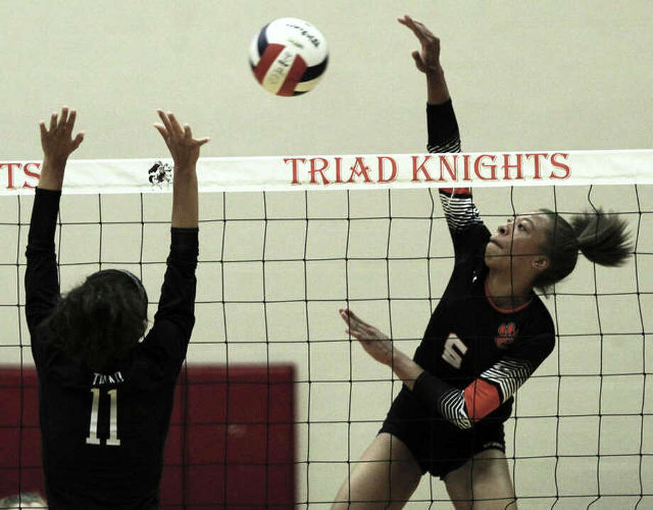 Edwardsville's Alexa Harris (right), shown attacking in a Tigers win Sept. 10 at Triad, put down 11 kills Wednesday in a Southwestern Conference volleyball victory over East St. Louis in Edwardsville. Photo: Greg Shashack / The Telegraph