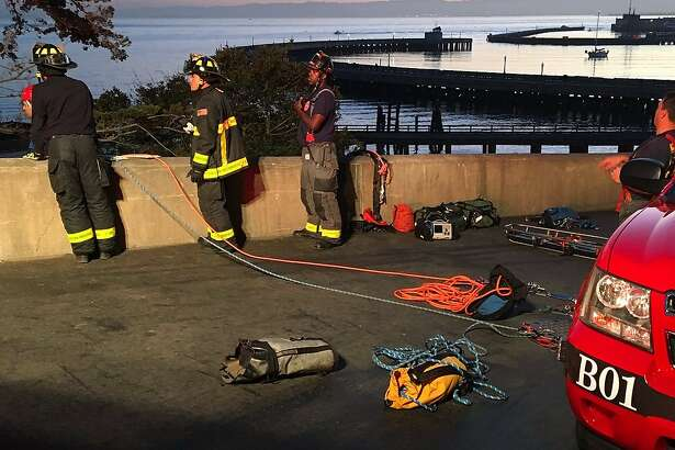 The San Francisco Fire Department responded to reports early Thursday of two people stuck on a cliff and another person in the water at San Francisco�s Aquatic Park, officials said.