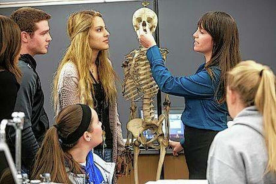 Miranda Karban, assistant professor of biology at Illinois College, instructs students in her anatomy class. Photo: Photo Provided