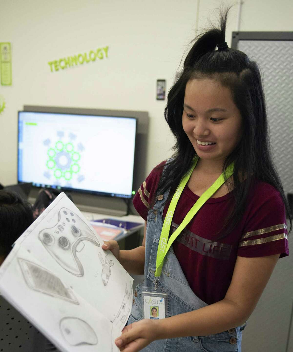 Yoube Htoo, 15, a freshman at CAST STEM, shows her engineering sketches during class on Thursday, September 6, 2018.