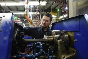 A worker at San Antonio-based Cox Manufacturing works on a machine. Manufacturers have continued to see growing business, but their future outlooks have become more pessimistic.