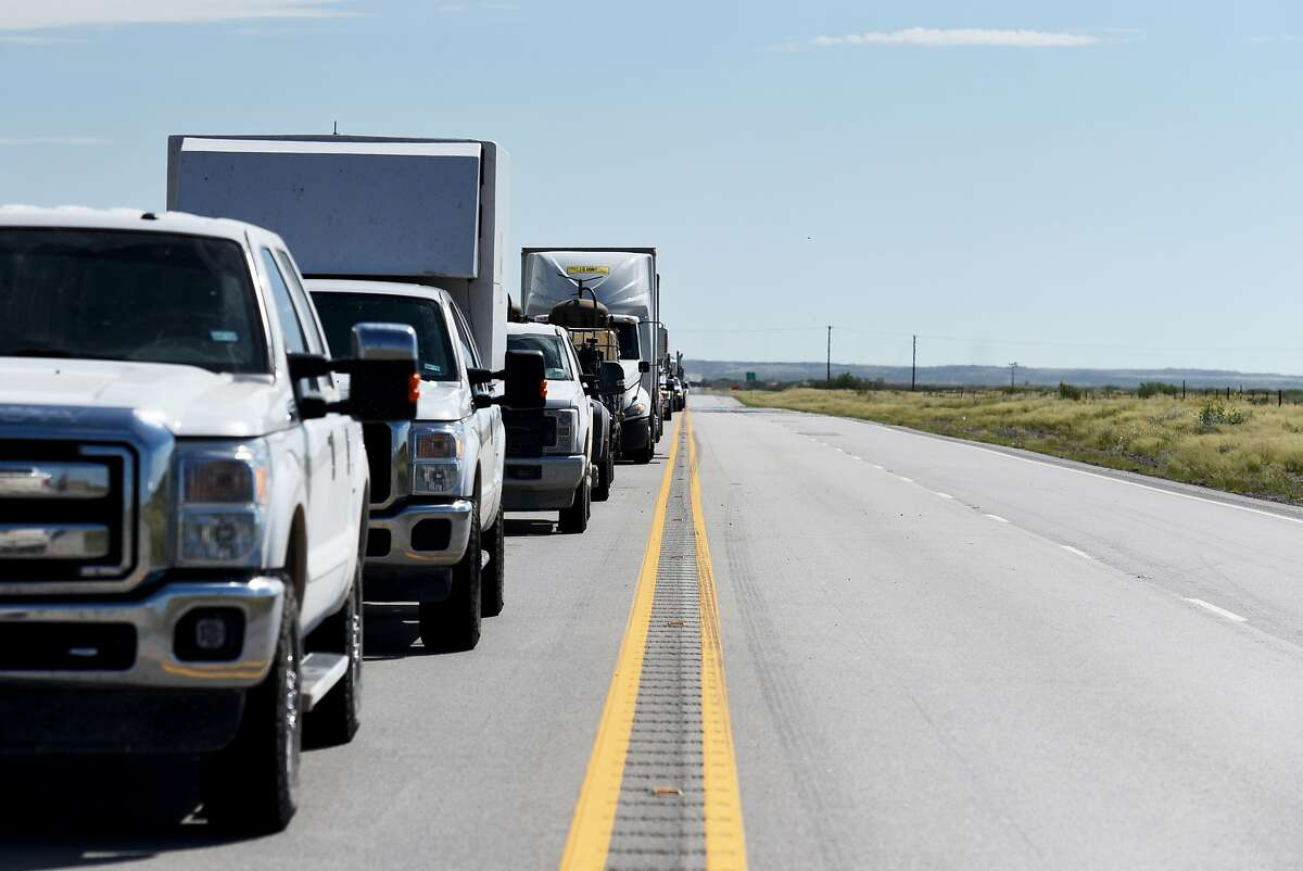 Vehicles sit in traffic on Highway 302 near Kermit, Texas, U.S., on Friday, Aug. 24, 2018. Texas' economy came to a near-standstill amid the COVID-19 pandemic and suffering the ramifications of a plunge in energy activity and oil and gas prices.But that doesn't eliminate the need to invest in the state's roads, according to the Texas Association of Business.