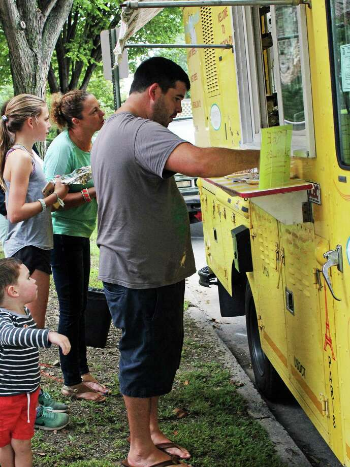 Customers check out some free samples from Christophe's Crepes, one of the 28 food trucks that will be part of the Friends of the Fairfield Public Library Food Truck Festival Sept. 30 at Jennings Beach. Fairfield,CT. 9/18/18 Photo: Genevieve Reilly / Hearst Connecticut Media / Fairfield Citizen