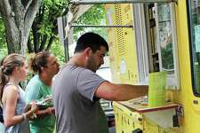 Customers check out some free samples from Christophe's Crepes, one of the 28 food trucks that will be part of the Friends of the Fairfield Public Library Food Truck Festival Sept. 30 at Jennings Beach. Fairfield,CT. 9/18/18