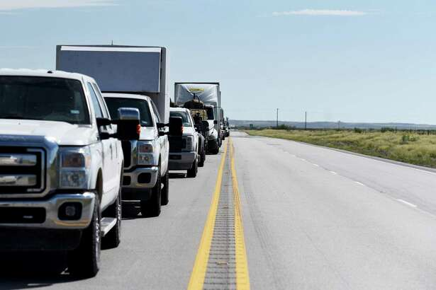 Vehicles sit in traffic on Highway 302 near Kermit, Texas, U.S., on Friday, Aug. 24, 2018. In the often upside-down world of West Texas, the biggest problem with building more roads is not the physical cost of the materials, but a lack of available workers and affordable housing. It's tough to match the high pay offered in the oilfields. Photographer: Callaghan O'Hare/Bloomberg