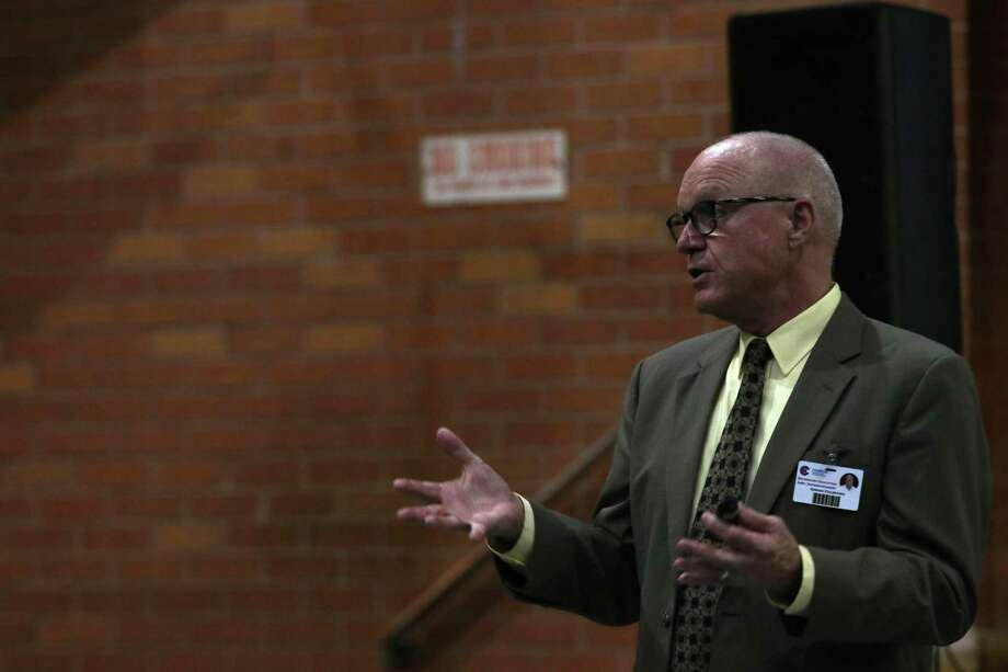 Gregg Colschen, Conroe ISD assistant superintendent for secondary education, speaks about the history and potential future of Booker T. Washington Junior High School during a community meeting Wednesday, Sept. 19, 2018 at the Booker T. Washington Junior High School. Future plans include turning the junior high school into an alternative learning high school. Photo: Cody Bahn, Houston Chronicle / Staff Photographer / © 2018 Houston Chronicle