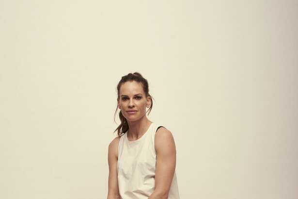 Actress Hilary Swank unveils a new women's clothing collection at Nordstrom. Prices are $145 to $1150.