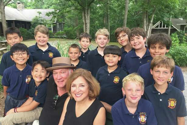 David Pittsinger (in hat) with wife Patricia Schuman and members of the Trinity Men & Boys Choir.