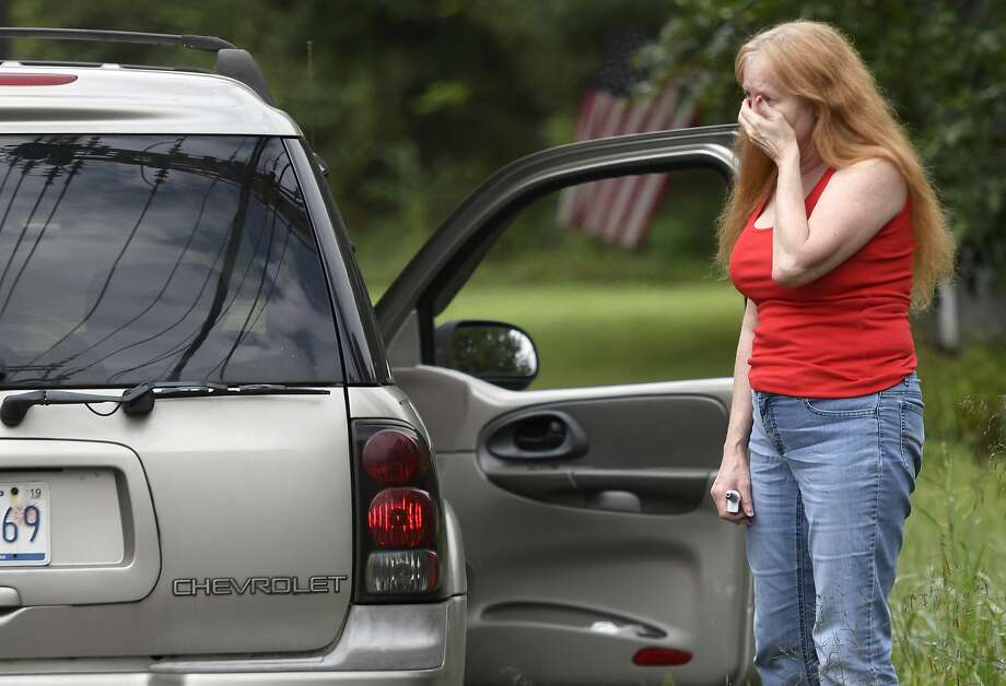 """Shirley Pollack, of Perryville, Md. reacts to what authorities have called a shooting with multiple victims in Perryman, Md. on Thursday, Sept. 20, 2018. Authorities say multiple people have been shot in northeast Maryland in what the FBI is describing as an """"active shooter situation.""""   Pollack,was concerned about her son  who worked near the scene of the shooting.  (AP Photo/Steve Ruark) Photo: Steve Ruark, Associated Press"""