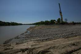 A ramp is built as contractors stage equipment for the Army Corps of Engineers' planned dredging of the West Fork of the San Jacinto River east of U.S. 59.