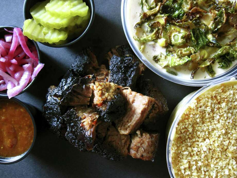 Angus brisket burnt ends with creamed corn and mac and cheese from Black Board Bar B Q on Sisterdale Road outside Boerne. Photo: Mike Sutter /Staff