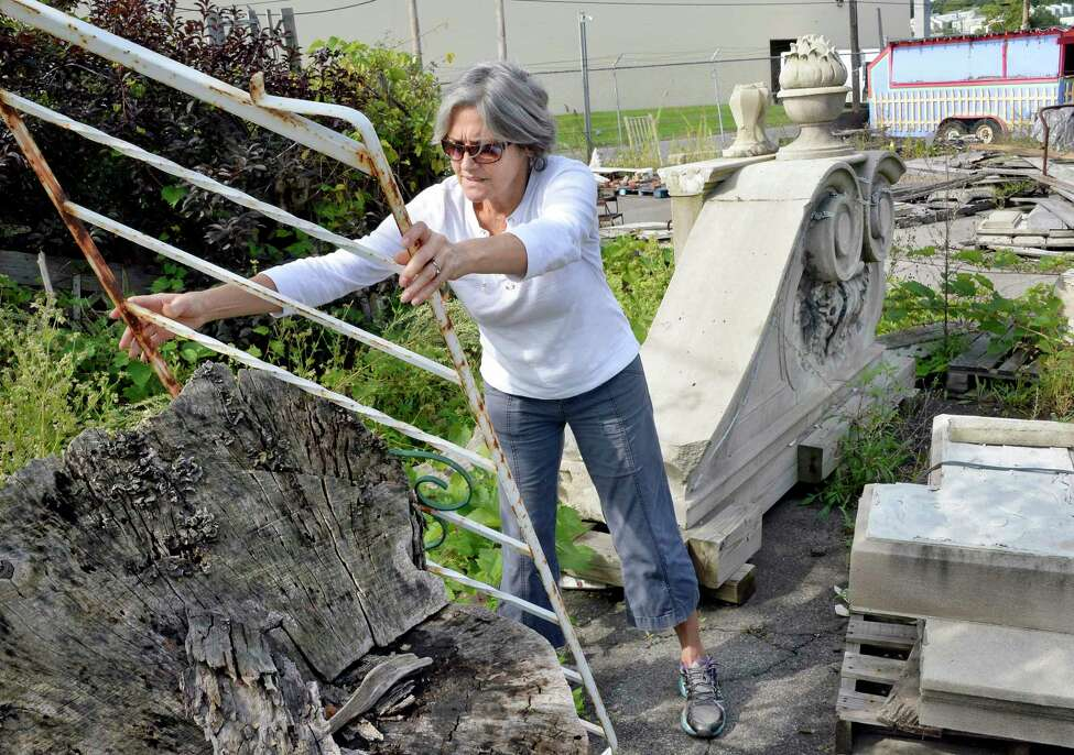 Silver Fox Salvage's Camille Gibeau moves items in their yard as she prepares to go out of business after more than a dozen years Thursday Sept. 20. 1018 in Albany, NY. (John Carl D'Annibale/Times Union)