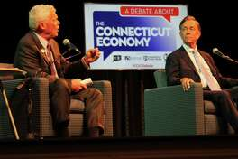 Independent candidate Oz Griebel, left, debates the economy with Democratic contender Ned Lamont at a meeting of the two gubernatorial candidates on Sept. 5, 2018. The two also took some shots at Bob Stafanowski, the Republican contender, who didn't attend.