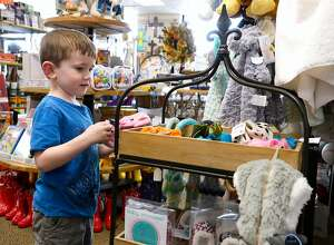 Curtis Fontenot, 4, browses the toy section at the Flagship Mail Room in Beaumont. The gift and shipping store hires seasonal workers to help as holiday shoppers browse for gifts and ship them to friends and family. Photo taken Tuesday 9/18/18 Ryan Pelham/The Enterprise