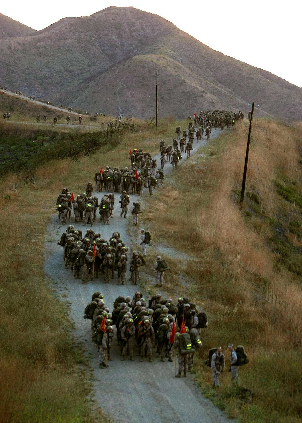 The Marine platoon regroups on top of the summit during the Reaper Hike, seperating into individual squars for the hike back to camp., at Camp Pendleton, Calif. Photo by Michael Macor/ San Francisco Chronicle