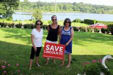 Residents Mary Anne Liesner, Tina Torraco, and Joan Miller, all members of the group, Westport Neighbors United LLC, stand in the front yard of Torraco's home on Westport's Riverside Avenue on Aug. 6.
