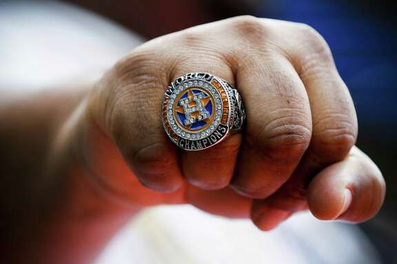 Houston Astros fan Tim Thorn shows off his replica World Series ring before the Astros home opener against the Baltimore Orioles at Minute Maid Park on Monday, April 2, 2018, in Houston. ( Brett Coomer / Houston Chronicle )