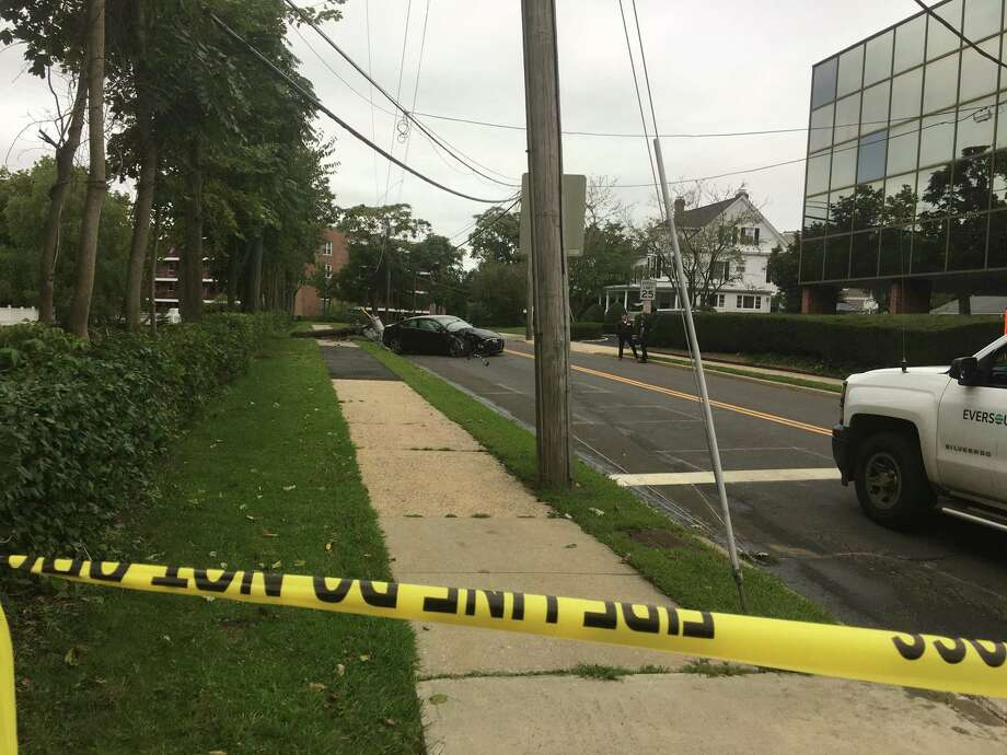 An Audi crashed Thursday morning into a power pole on Brookside Drive, between ACME and the Greenwich Close apartments, knocking out power in the area. Photo: / Contributed By Guillermo Novella