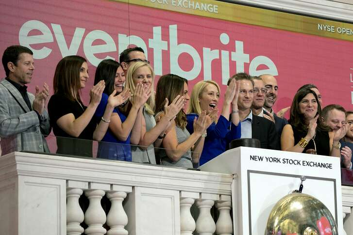 Eventbrite CEO Julia Hartz, center, and Kevin Hartz, right center, her husband and company chairman, celebrate as she rings the New York Stock Exchange opening bell, Thursday, Sept. 20, 2018, to mark the company's IPO. (AP Photo/Richard Drew)