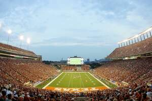 FILE - Fans cheer on the Texas Longhorns against the Louisiana Monroe Warhawks on September 5, 2009 at Darrell K Royal-Texas Memorial Stadium in Austin, Texas.  (Photo by Brian Bahr/Getty Images)