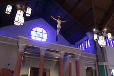 A crucifix, a symbol of Jesus Christ dying on the cross, hangs in the sanctuary at St. Anthony of Padua's Catholic Church in The Woodlands.