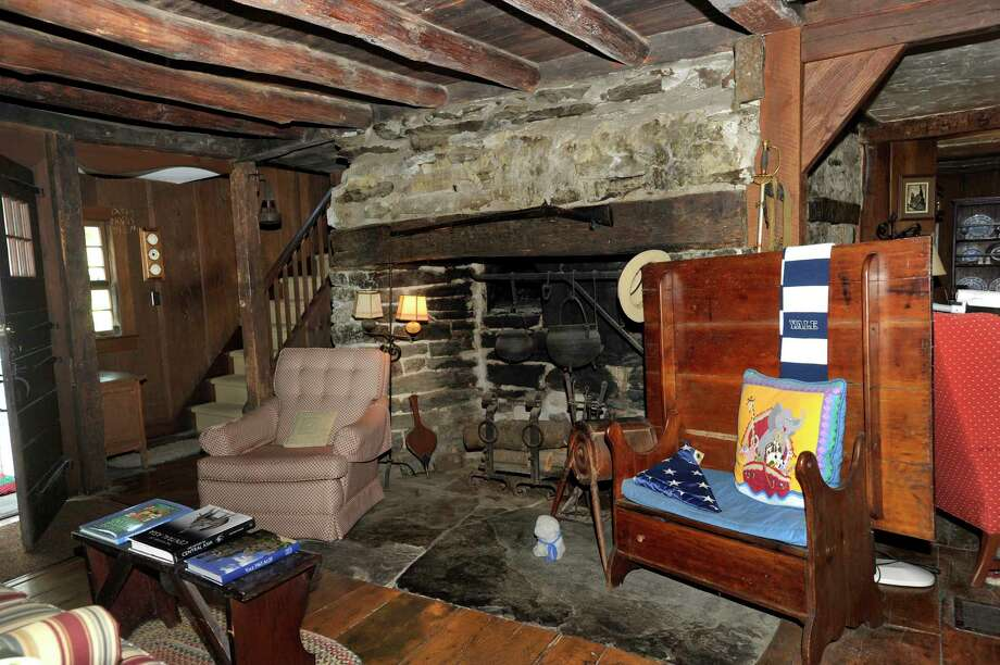 A fireplace off of the kitchen area in the historic Cogswell Tavern in Washington, Ct., now a private home.  Photo Wednesday, Sept. 19, 2018. Photo: Carol Kaliff, Hearst Connecticut Media / The News-Times