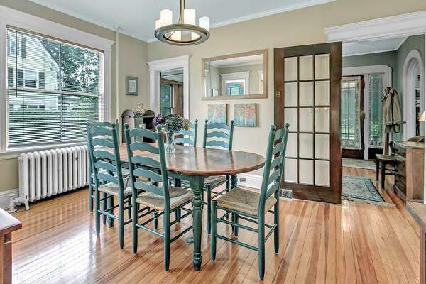 """The four-bedroom Colonial at 38 Governors Avenue in Milford has been home to the Harrison family for at least 100 years. Four generations of Harrisons have lived there, starting with Charles Harrison -- who was the """"Harrison"""" in Harrison and Gould hardware store, a longtime Milford institution. Built in 1915, current owner Bill Harrison said members of his family have lived there at least since 1918."""