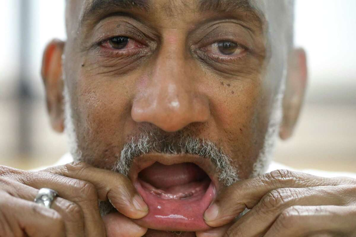 """PHOTOS: Rules in Texas prisonsDavid Ford, an inmate at the Huntsville Unit, has had trouble getting dentures while in prison. """"You ain't gonna see nothin,"""" he said while showing his toothless smile Friday, Sept. 14, 2018, in Huntsville.>>>See other rules that inmates in Texas must live by..."""