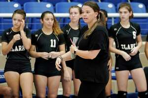 Clark head coach Melissa Miller talks to her players during a high school volleyball match against Southwest, Friday, Aug. 10, 2018, at Northside Sports Gym in San Antonio. (Darren Abate/Contributor)