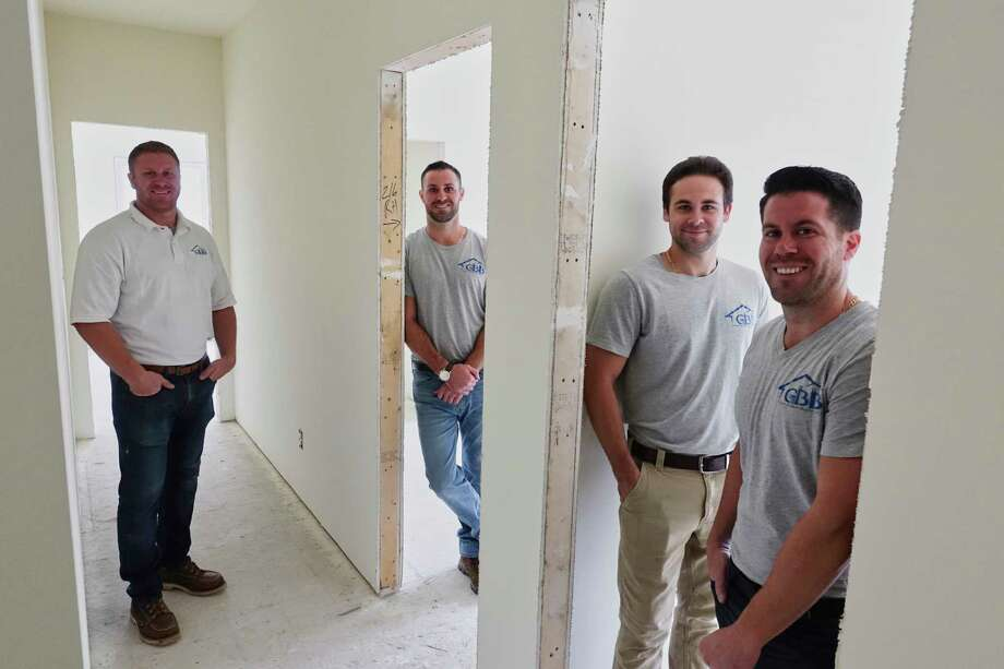 Griner brothers, from left to right, Mike, Joe, Dan and John, owners of Griner Bros. builders, pose inside one of the homes they are building on Tuesday, Sept. 18, 2018, in Guilderland, N.Y. (Paul Buckowski/Times Union) Photo: Paul Buckowski / (Paul Buckowski/Times Union)