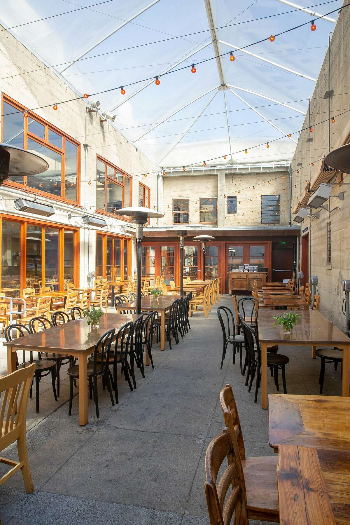 The courtyard where movies are shown in Foreign Cinema at 2534 Mission St, San Francisco