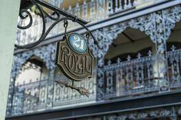 An exterior sign outside 21 Royal in New Orleans Square.