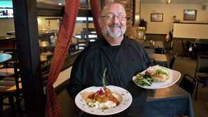 Mike Cirelli with dishes in his Sans Souci restaurant Wednesday Sept. 12, 2018 in Cleverdale, NY.  (John Carl D'Annibale/Times Union)
