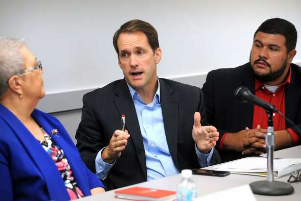 Congressman Jim Himes speaks at a public forum updating federal, state and local relief efforts one year after Hurricane Maria devasted Puerto Rico, in Bridgeport, Conn. Sept. 20, 2018. Himes is seen here with Rosa Correa, left, coordinator of Bridgeport?'s Puerto Rican Relief Center, and State Rep. Christopher Rosario, right.