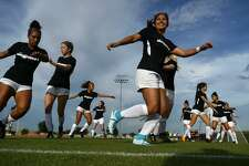 Lamar women's soccer players warm up before playing against Rice in their season-opening exhibition game. Photo taken Wednesday 8/8/18 Ryan Pelham/The Enterprise