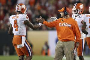 TAMPA, FL - JANUARY 09: Clemson Tigers head coach Dabo Swinney congratulates Clemson Tigers quarterback Deshaun Watson (4) after he threw a pass for a touchdown in the 4th quarter of the 2017 College Football National Championship Game between the Clemson Tigers and Alabama Crimson Tide on January 9, 2017, at Raymond James Stadium in Tampa, FL. Clemson defeated Alabama 35-31. (Photo by Mark LoMoglio/Icon Sportswire via Getty Images)