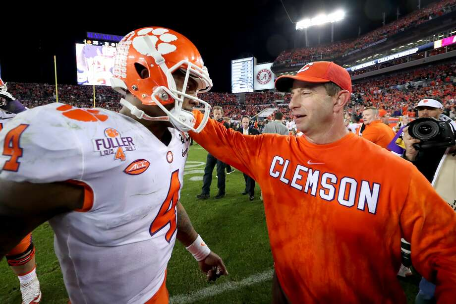 Current Texans quarterback Deshaun Watson (left) won the 2017 national championship with Clemson and Dabo Swinney before the Texans took him in the first round of the NFL Draft. Photo: Tom Pennington/Getty Images