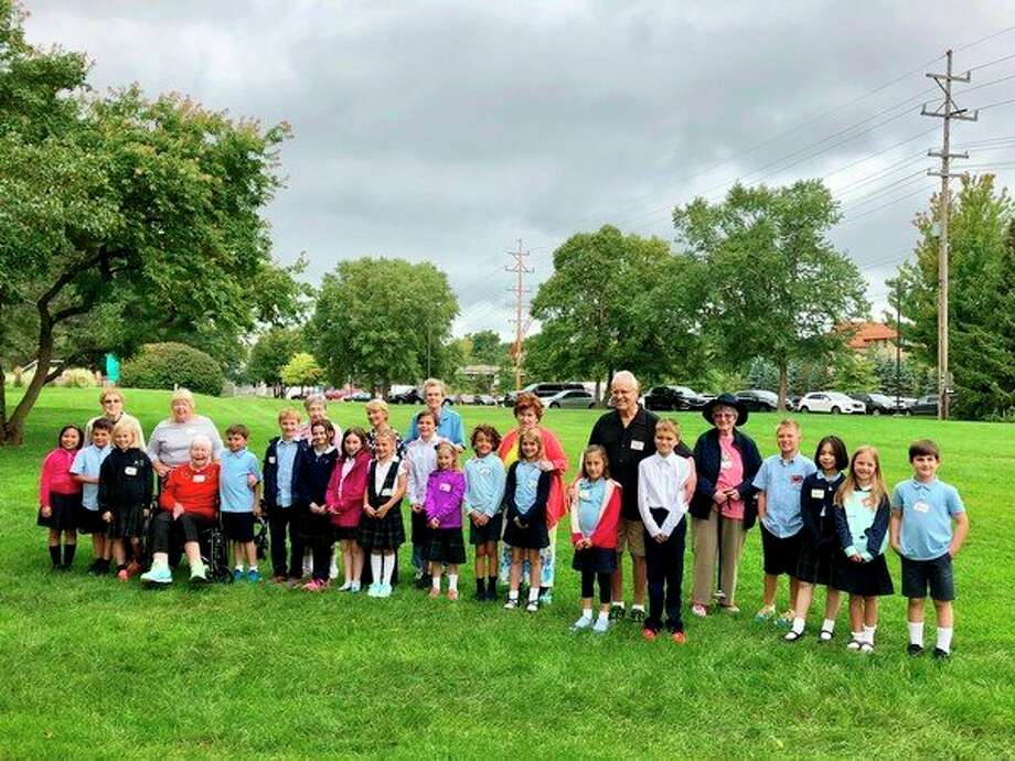 Third-graders from St. Brigid Catholic School and residents from Riverside Place pose for a picture after meeting this week. (Photo provided)