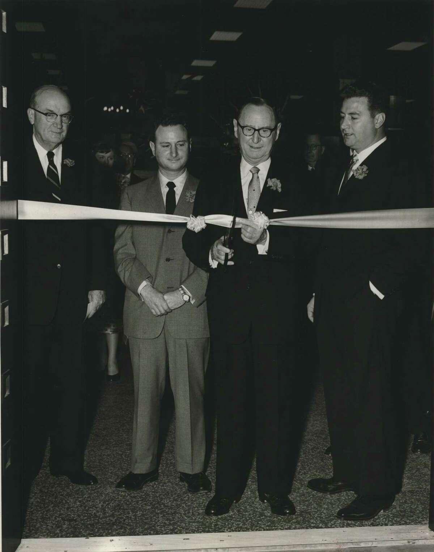 Officials at ribbon cutting at new Houston Norton Ditto store. Houston, Texas. Ribbon shearing.