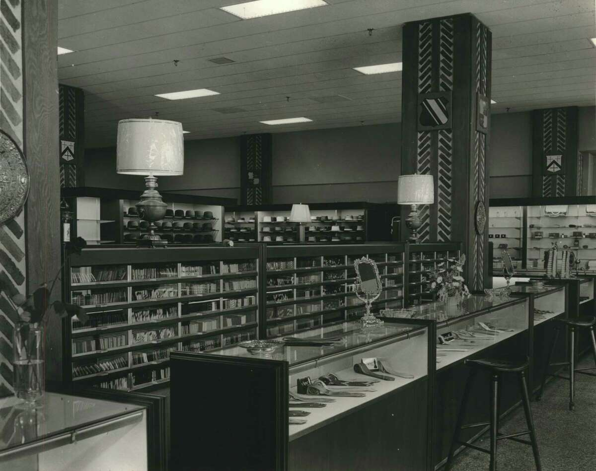 03/1956 - Interior of new Norton-Ditto store in Bank of the Southwest Building in Houston, Texas. Tie counter seen in foreground; hat department in back.