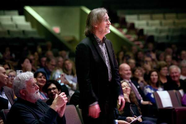 Jackson Browne stands to listen to a proclamation in his honor from the City of New Haven before accepting the Gandhi Peace Award from Promoting Enduring Peace at the Lyman Center for Performing Arts at Southern Connecticut State University in New Haven Sept. 14.