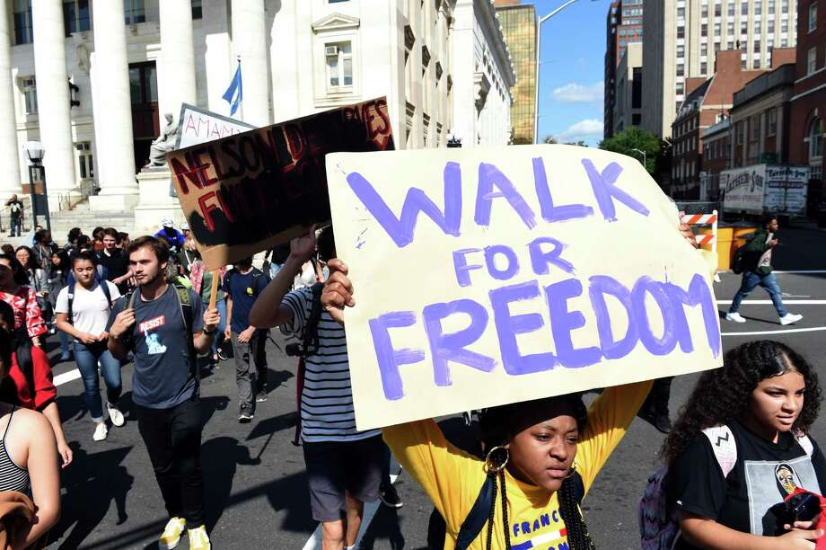 Wilbur Cross High School, Common Ground High School and Yale University students march toward City Hall in New Haven. Photo: Arnold Gold / Hearst Connecticut Media / New Haven Register