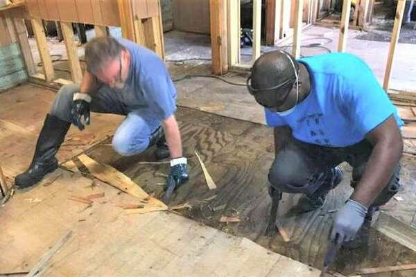 Volunteers help strip a house in Baytown, Texas after Hurricane Harvey devastated the Houston area last year. A volunteer group of the Bethalto Church of God is asking for donations before traveling to LaGrange, North Carolina next week, to supply goods to those recently impacted by Hurricane Florence.